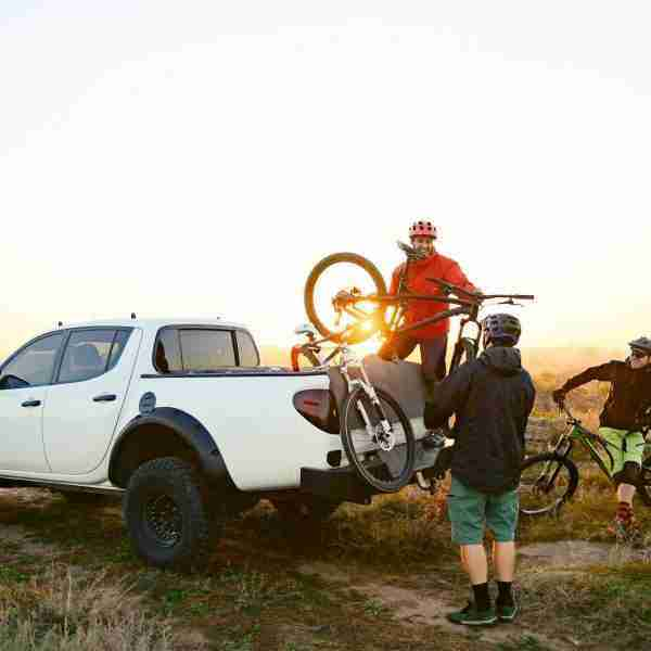 Check out the best tailgate bike pads for your truck and learn about the pros and cons of using one to haul your bikes to and from the trail