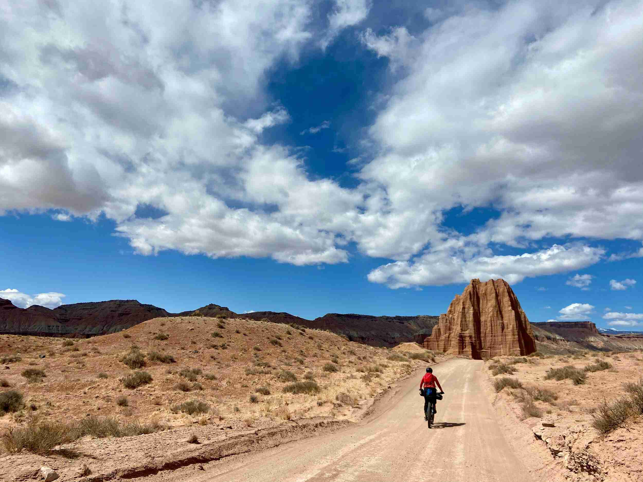 The Cathedral Valley Loop in Capitol Reef National Park is a perfect overnight bikepacking adventure with incredible views and mellow pedaling