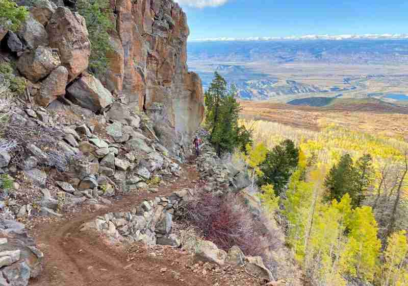 Learn everything you need to know about mountain biking the Palisade Plunge trail in Colorado including shuttles, maps, trail tips, and more.